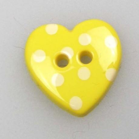 Bouton coeur jaune à pois