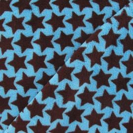 Tissu Doudou motif étoilé marron fond turquoise x 10cm