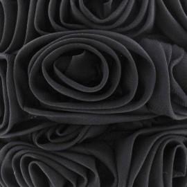 Galon rose sur tulle noir 50 cm