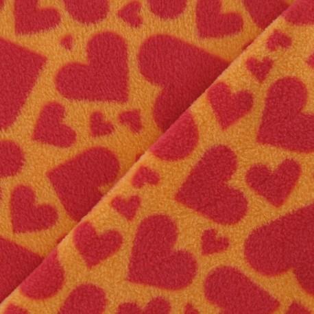 tissu polaire coeur rouge fond orange x 10cm ma petite mercerie. Black Bedroom Furniture Sets. Home Design Ideas