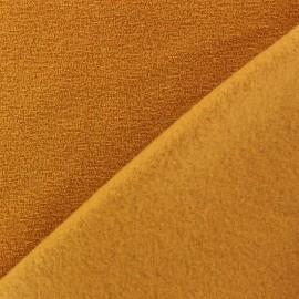 Tissu Polaire bouclée moutarde x 10cm