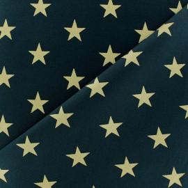 Tissu Noël grandes étoiles doré fond vert sapin