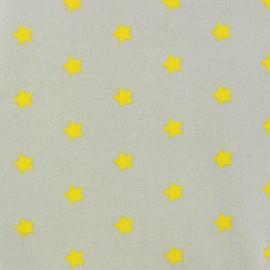 Tissu enduit Etoiles MAGIC  beige / jaune x 10cm