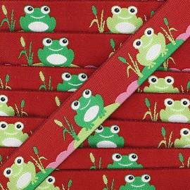 Ruban grenouilles fond bordeaux