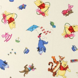 Tissu coton Disney Toyplay crème x 64cm