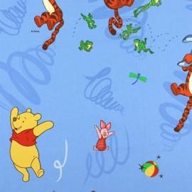 Tissu coton Disney Winnie the Pooh Jumpe bleu x 63cm