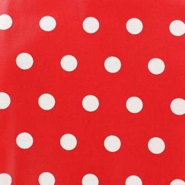 Tissu enduit coton pois blancs sur fond rouge vermillon x 10cm