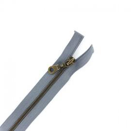 Fermeture Eclair® laiton séparable gris clair