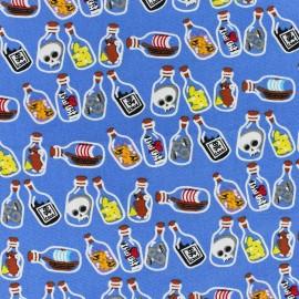 Tissu coton Pirate's Poison bleu x 10cm