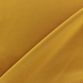 Tissu Lycra épais moutarde x 10cm