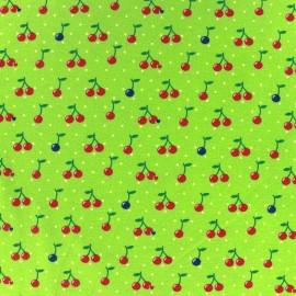Tissu Jersey Cherry Dot fond vert anis x 10cm