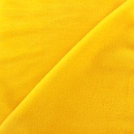 Tissu sweat envers minkee jaune x 10cm