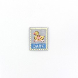 Baby label with toy iron-on applique - grey