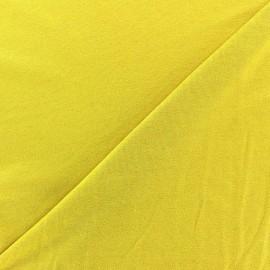 Tissu jersey viscose léger pailleté moutarde x 10cm