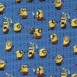 Tissu Jersey Les Minions Préhistoire bleu x 27cm