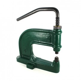 Manual press machine for double cap rivets, snap fasteners