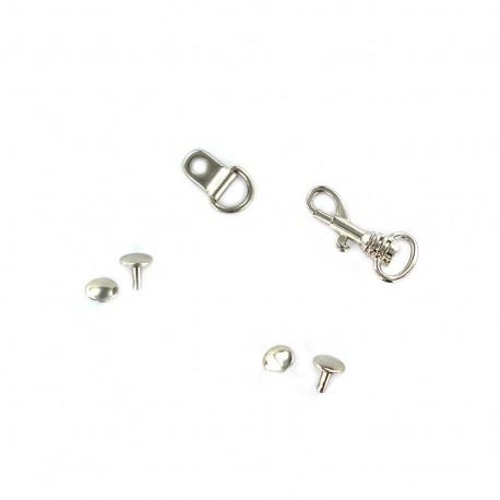 Complete metal fastener for bag handles - silvery