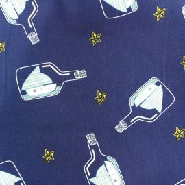Tissu coton Une bouteille à la mer - marine x 10cm