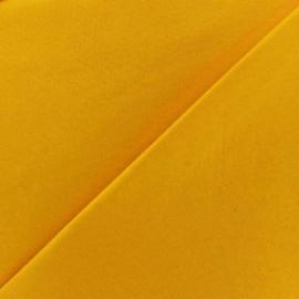 Tissu Jersey uni 100% coton - jaune x 10cm
