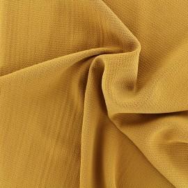 Tissu crêpe gaufré uni - moutarde x 10cm