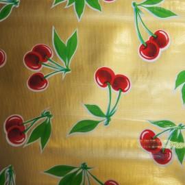 Tissu toile cirée cerise fond doré x 30cm