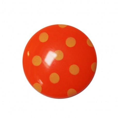 Bouton à pois orange attache au dos