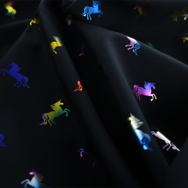 Tissu Softshell Shiny Unicorns - multi/noir x 10cm