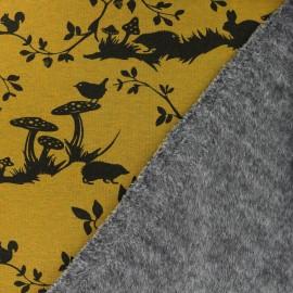 Tissu sweat envers minkee The magical forest - jaune moutarde x 18cm