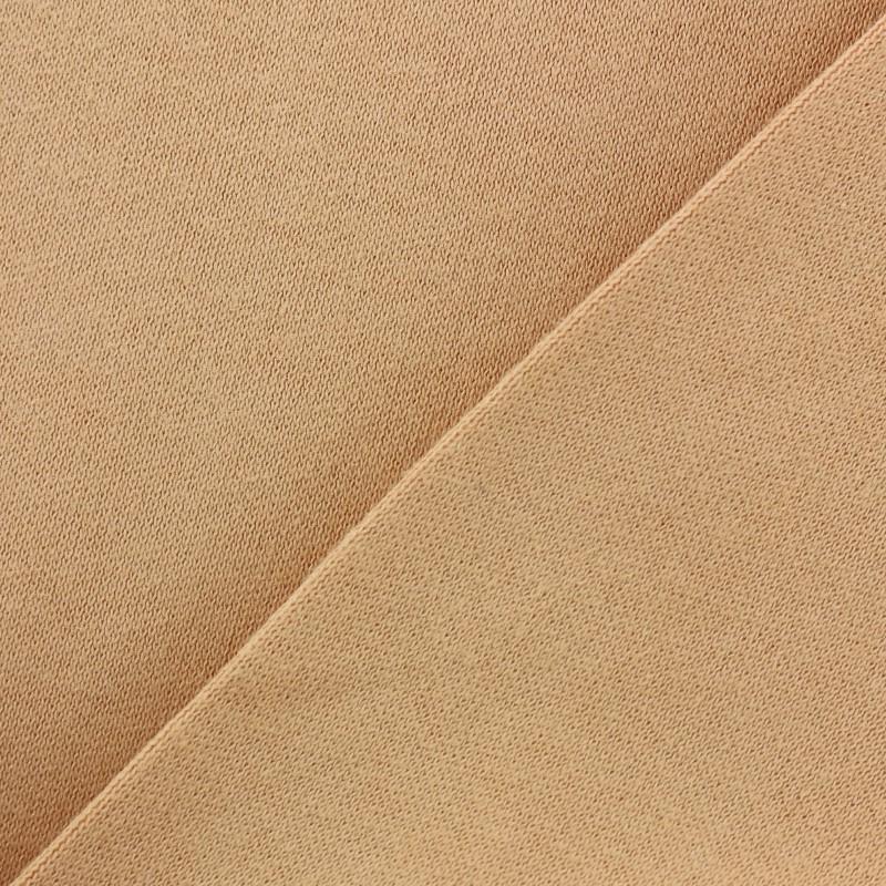 be1d3ff9c524f Tissu Jersey peau poupée fin - pêche x 10cm