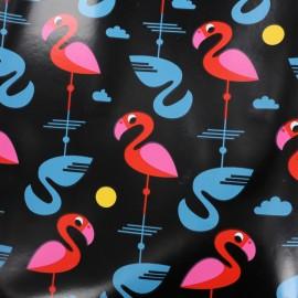 Tissu toile cirée Flamants roses et bleus - noir  x 10cm
