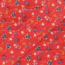 Elastique plat fantaisie 40 mm Petites fleurs bleues fond rouge