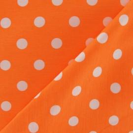 Tissu Gabardine Lycra pois blancs sur fond orange fluo x 10cm