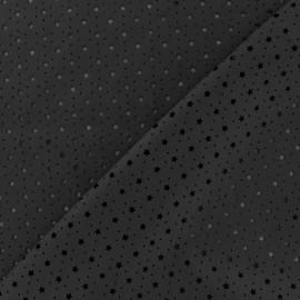 Simili cuir souple ajouré Stars noir x 10cm