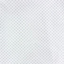 Tissu dévoré champs de pois blanc x 10cm