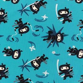 Tissu Jersey Mini Ninja fond turquoise x 10cm