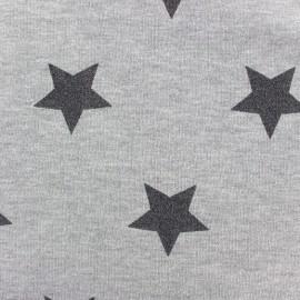 Tissu sweat envers minkee gris clair grandes étoiles pailletées noir x 10cm