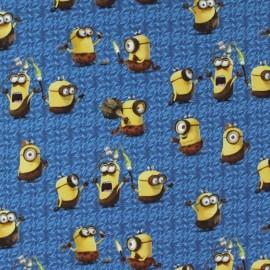 Tissu percale Les Minions Préhistoire - bleu x 27cm